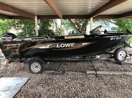 2014 Lowe FM 165 Pro Series Fishing & Sport boat. In excellent condition, used only a few times. Includes trolling motor, boat cover, bow and stern live wells, FM (fishing machine).