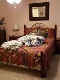 Queen size iron and wood bed