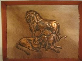 Embossed Copper Lions on Springbok Hide background