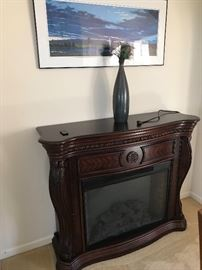 I know it is hot out but winter is around the corner.  Great addition to your decor.  Electric Fireplace