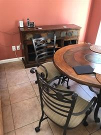 Wrought Iron and wood with stone, Round table, Chairs on rollers, Buffet and Credenza.  Fun Set or purchase just a piece!!