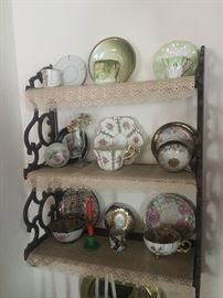 Assorted antique tea cups and saucers