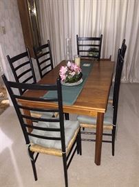Danish Modern dining set Mint condition with slide out leaves at each end