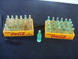 miniature plastic coke bottles and cases