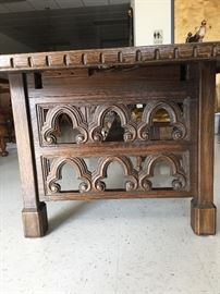 Jacobean table with 8 chairs with hidden leaves.  When fully extended could seat 12-14 guest more if you have smaller chairs.
