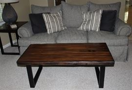 Rustic Slab Wooden Black Steel Base Coffee Table and Matching End Table shown with Bernhardt Gray Tweed 3 Cushion Sofa with 3 loose plush Back Pillows