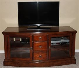 """Samsung 39"""" Flat Screen TV shown on the Cherry Finish TV Entertainment Center w/Double Glass Doors & 3-Center Drawers (29 1/2""""H x 60 1/2""""W x 26"""" Centered Depth).   Also shown is a Phillips Prgressive Scan Dual 4-Head VHS Recorder - DVD/CD Player  in interior Cabinet"""