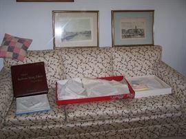 THREE CUSHION CHINTZ SOFA, TABLE LINENS & PRINTS