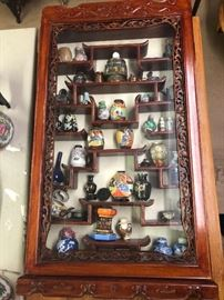 asian wall display with contents nice