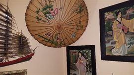 paintings, umbrellas, wall hangings