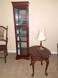 Lighted curio cabinet. End table