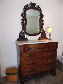 Antique Victorian era 4-drawer chest with marble top and mirror.
