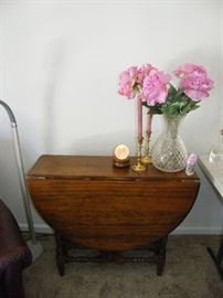 drop leaf gate leg table with crystal vase and brass accessories