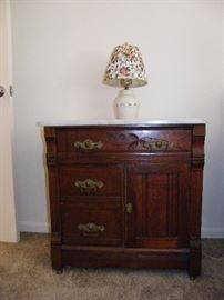 Antique Victorian era commode chest with marble top.