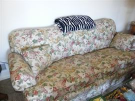 Floral upholstered sofa.