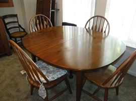 Dining table with Windsor style chairs.