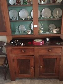 Collection of Frankoma plates inside the hutch.
