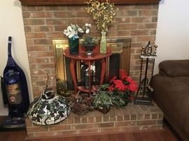 Lots of home decor, small table, fireplace set, and great Tiffany style lamp