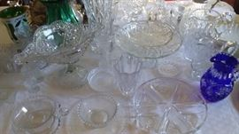 Large crystal collection of vases, pitchers, serving dishes of various sizes and some antique pieces