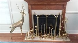 Brass collection includes matching Baldwin fireplace tools and andirons and some Baldwin candlesticks.