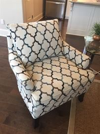 one of two upholstered club chairs