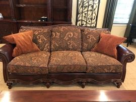 There are (2) of these extremely relaxing stunning leather, grommet lined sofas. Upholstered cushions with decorative accent pillows.