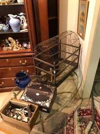 Old bird cage and brass coffee table