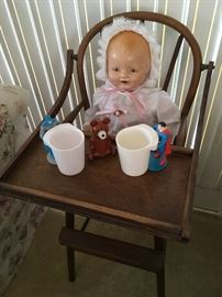 Composition Horseman doll in antique highchair