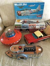 Sample of unassembled boxed vintage models.  Steel friction toys