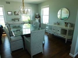 dining room with glass table, crate and barrel chairs and distressed mid-century buffett