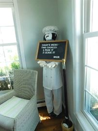 tall chef with menu