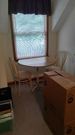 Small table and chairs in upstairs apartment