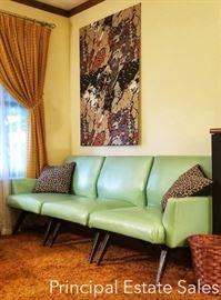 MCM retro modular vinyl sofa in sea-foam green...did I say MODULAR?!
