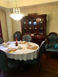 Eloquent dining room table and chairs.  China cabinet