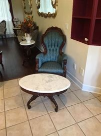 Antique wing chair and marble top table