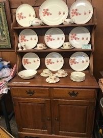 W,S, George Strawberry Shortcake dishes displayed in small maple hutch
