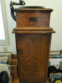 This is a 1920's Victrola.  It winds up and really works!