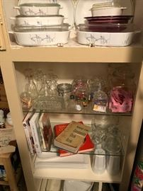 a cabinet full in the kitchen. interesting corning ware pattern