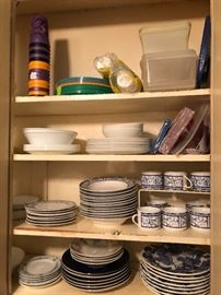 kitchen cabinet full of blue and white dinnerware