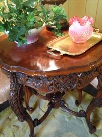 Beautifully carved side table; brass tray and Fenton vase