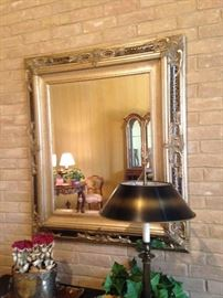 Gold framed mirror; metal lamp