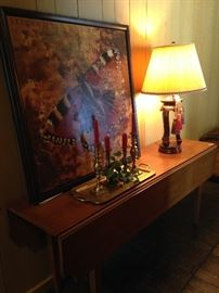 Long drop leaf table; large butterfly picture; brass tray and candlesticks