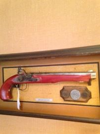 Framed antique (not real) gun