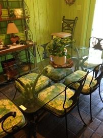 Glass top iron table and 6 matching chairs with cushions