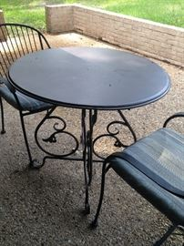 Another patio table with 2 chairs