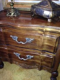 Two-drawer nightstand matches the triple dresser