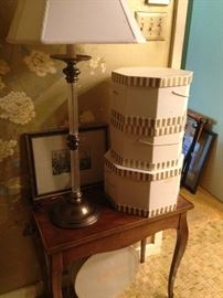 Small table; lamp; hat boxes