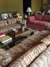 Two matching 3-cushion sofas