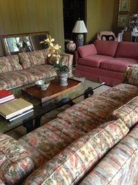 Two matching 3-cushion sofas