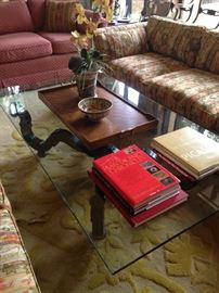 Large glass top coffee table; great coffee table books; wooden tray